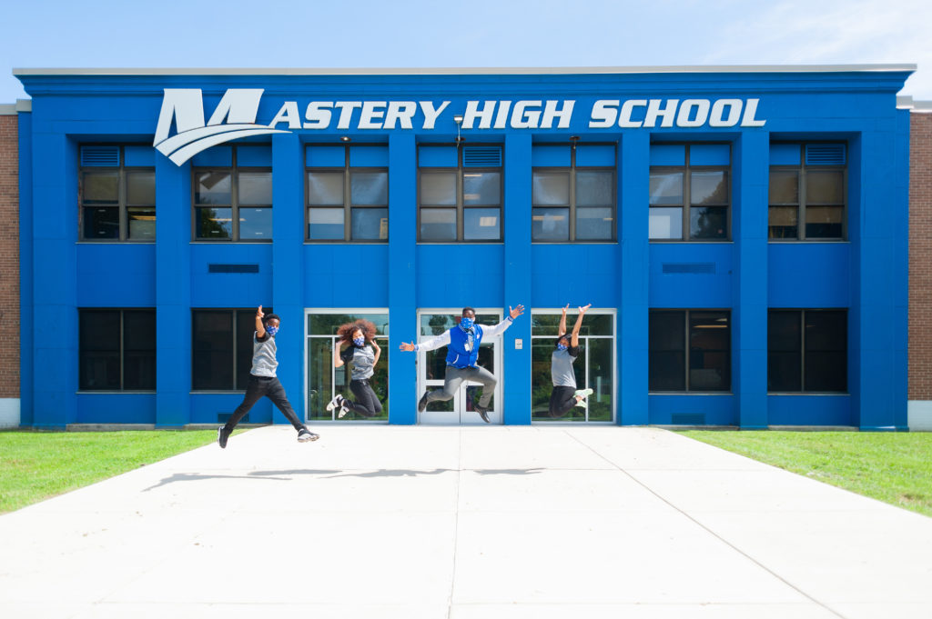 https://masterycharter.org/app/uploads/2020/08/MHSC-2020.2021-Principal-Will-Hayes-students-exterior-jump-1024x681.jpg
